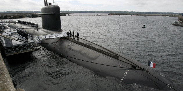 French Marine officers wait atop « Le Vigilant » nuclear submarine prior to the visit of France'sPresident Sarkozy
